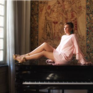 pink ruffled dress piano